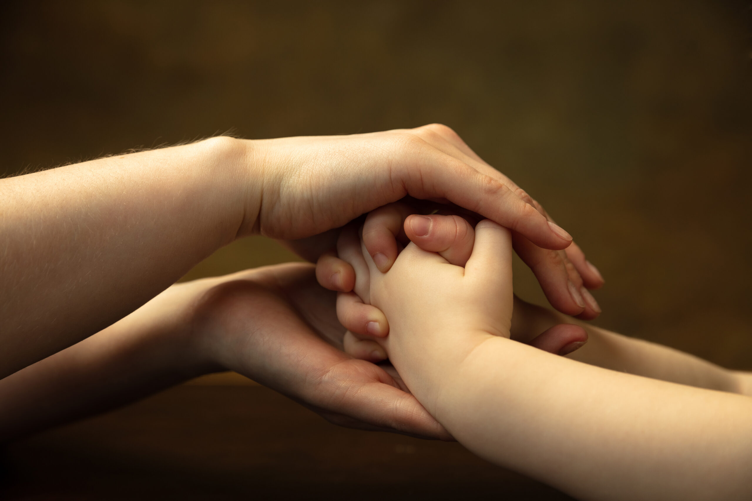 holding hands clapping like friends close up shot female kid s hands doing different things together family home education childhood charity concept mother son daughter wealth